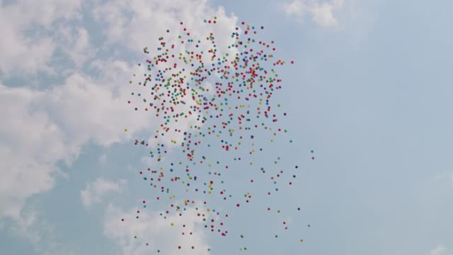 balloons flying into the sky - releasing stock videos & royalty-free footage
