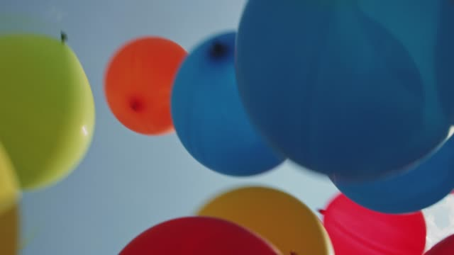 balloons flying into the sky - birthday gift stock videos & royalty-free footage
