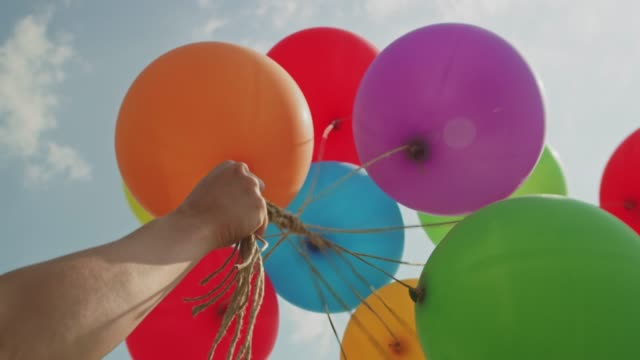 balloons on strings - helium stock videos & royalty-free footage