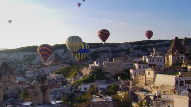 balloons over goreme 1 fast - cappadocia stock videos and b-roll footage