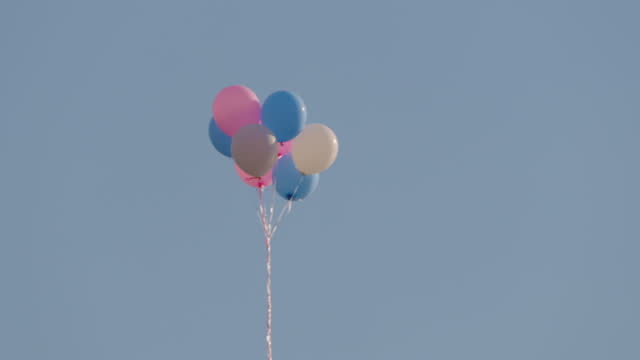 balloons tied by string and flying / new york, united states - surfacing stock videos & royalty-free footage