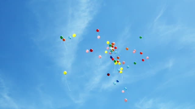 balloons (shot on red) - multi coloured stock videos & royalty-free footage