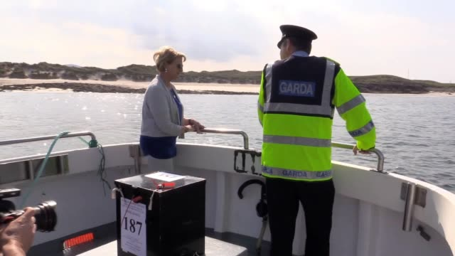 a ballot box is taken over to gola island in donegal as 12 islands on the west coast cast their votes in the irish abortion referendum a day before... - アルスター州点の映像素材/bロール