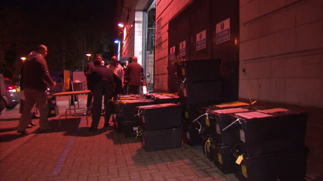 vídeos de stock, filmes e b-roll de ballot boxes arrive in birmingham ready for counting shows exterior night shots ballot boxes being carried from outside into counting hall on may 07... - título de eleitor