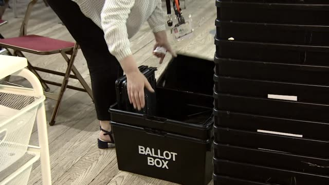 ballot boxes being packed away after the local elections - 英自由民主党点の映像素材/bロール