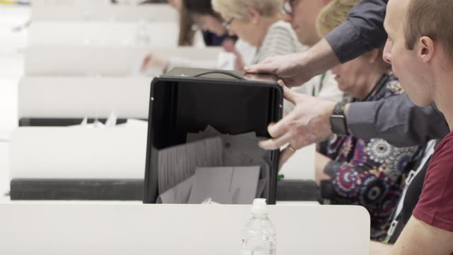 ballot papers being counted in the local elections - wahllokal stock-videos und b-roll-filmmaterial