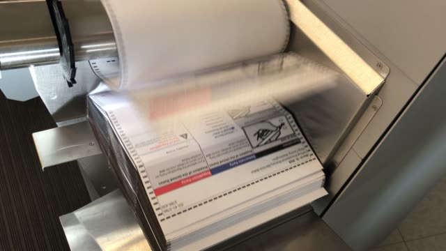 a ballot scanner at the king county elections processing center on march 09 2020 in renton washington election officials mandated wearing gloves in... - voting ballot stock videos & royalty-free footage