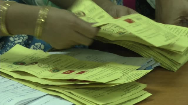 Ballots are counted at a polling station in Yangon during Myanmar's first free and fair election The elections will be Myanmar's first openly...