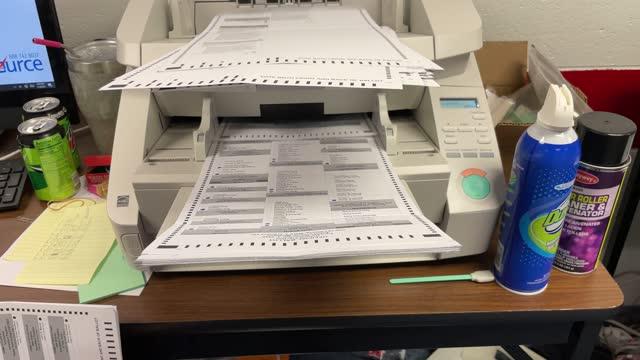 ballots scan at the lansing city clerk's office on election night on november 03, 2020 in lansing, michigan. president trump narrowly won michigan in... - ballot slip stock videos & royalty-free footage