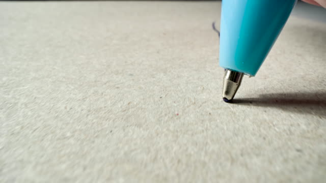 ballpoint pen writes or draws on paper - ballpoint pen stock videos & royalty-free footage