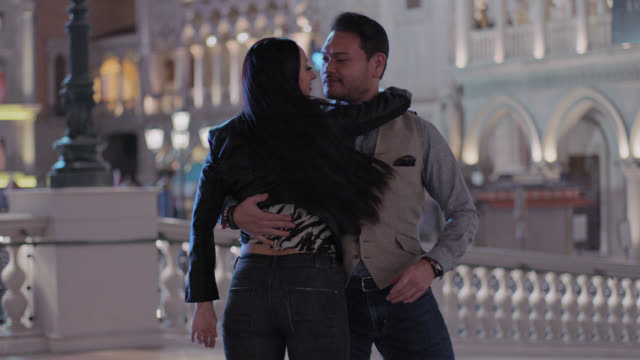 ballroom partners share a passionate dance outside las vegas casino. - tangoing stock videos & royalty-free footage