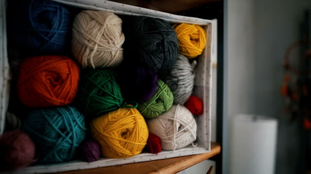 balls of yarn on shelves - ball of wool stock videos & royalty-free footage