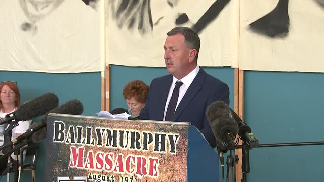 families press conference; press conference part 2 of 8 northern ireland: belfast: int john teggart press conference sot - woman holding up board... - news not politics stock videos & royalty-free footage