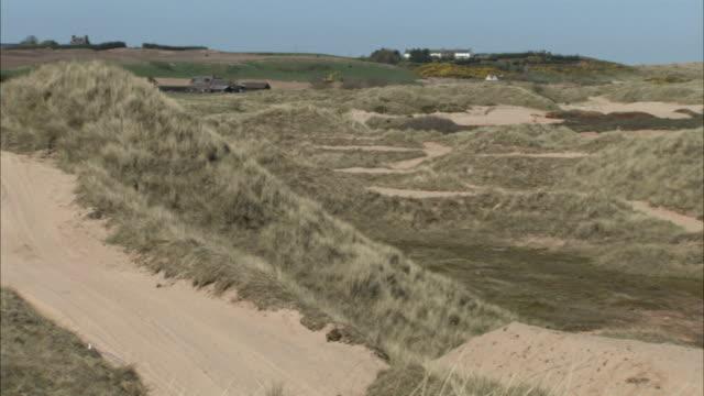 balmedie beach marram grass along sand dunes waves pond uk balmedie country park aberdeenshire - marram grass stock videos & royalty-free footage