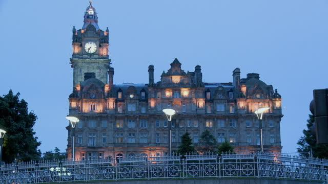 WS, Balmoral Hotel illuminated at dusk, Scotland, United Kingdom