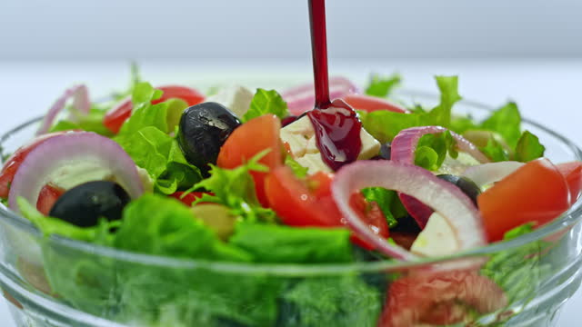 slo mo balsamic vinegar being poured onto a salad - slovenia stock videos & royalty-free footage