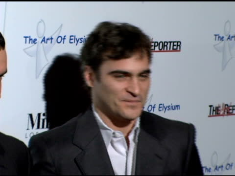 balthazar getty and joaquin phoenix at the art of elysium presentation of russel young 'fame shame and the realm of possibility' at minotti los... - joaquin phoenix stock videos & royalty-free footage