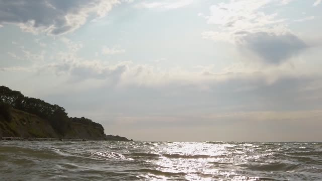 baltic sea waves in front of steep coast, clouds in the sky, sun - tina terras michael walter stock videos & royalty-free footage