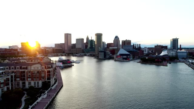 baltimore, maryland inner harbor at sunset - maryland delstat bildbanksvideor och videomaterial från bakom kulisserna