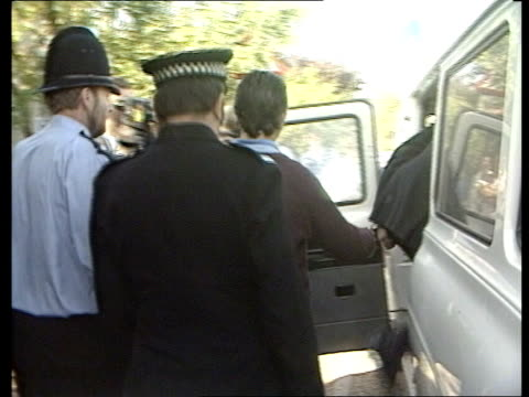 bambi murders; england: essex: maldon: jeremy bamber led l-r handcuffed to policeman to van and into van in bv video ex eng/lib tx 30.9.85/c4n... - gulf coast states stock videos & royalty-free footage