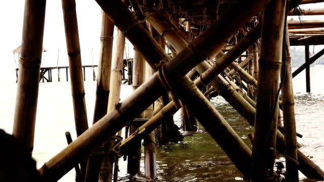bamboo bridge toward to the sea, koh mak, province trat in thailand. - trat province stock videos and b-roll footage