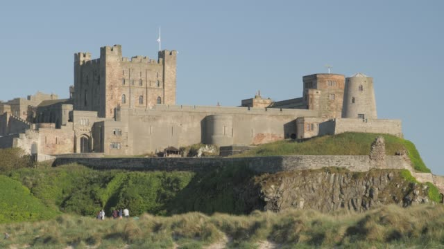 bamburgh castle from beach, northumberland, england, united kingdom, europe - northumberland coast stock videos & royalty-free footage