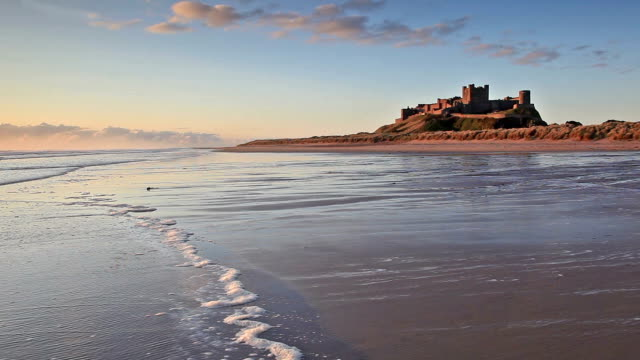 bamburgh castle on the northumberland coastline. - northumberland video stock e b–roll