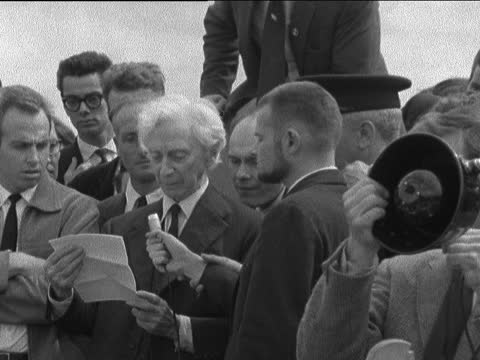 ban the bomb group remember dropping of the h-bomb:; england: london: hyde park: gv demonstrators along with banner 'hiroshima day vigil 6th august... - weapons of mass destruction stock videos & royalty-free footage