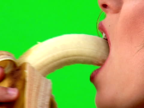 banana bite - banana stock videos & royalty-free footage