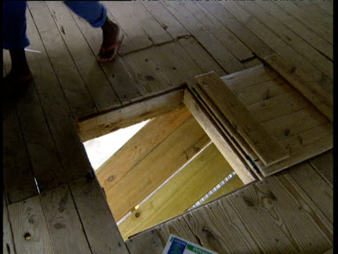 Banana boxes are thrown through trapdoor and tumble down wooden chute Windward Islands