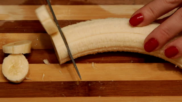 banana cutting,close up-super slow motion - knob stock videos & royalty-free footage