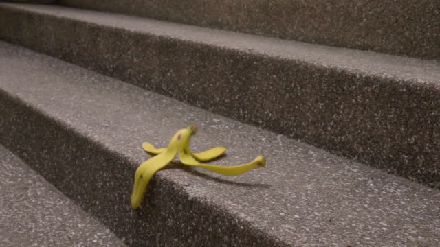 banana peels falling on stair slomo - falling stock videos and b-roll footage