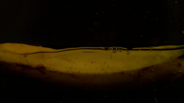 banana splashing into water (super slow motion) - slip banana stock videos & royalty-free footage