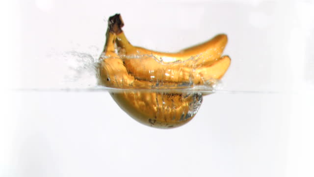 Bananas falling into water in super slow motion