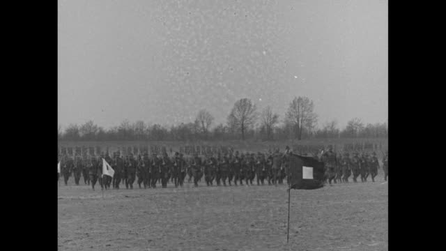 band and soldier marching across field, several carry american flags / soldiers at attention with flags, officers in front / officers in front of... - pinning stock videos & royalty-free footage