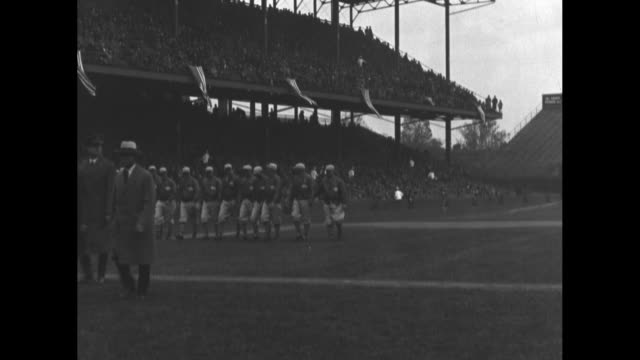 Band and teams march onto field prior to opening day game between Washington Senators and Philadelphia Athletics in Washington DC / CU radio...