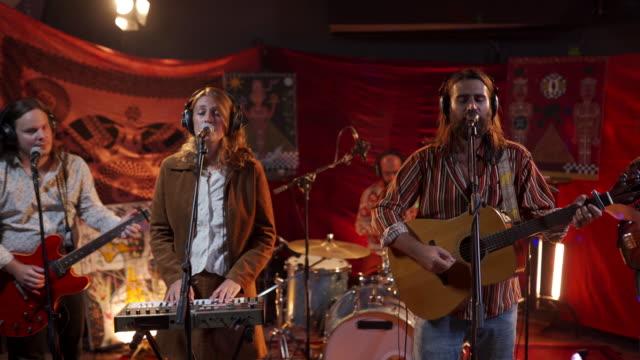 band enjoying making music together at stage - singer stock videos & royalty-free footage