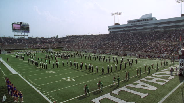 ws band in football stadium with people / unspecified - marching band stock videos & royalty-free footage