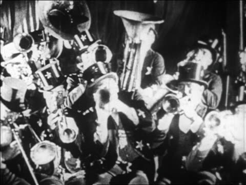 B/W 1928 band in top hats shaking heads as they play in nightclub / newsreel