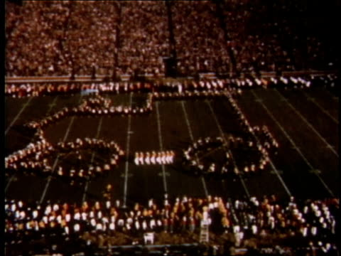 1951 ha band marching down football field in the shape of an automobile / detroit, michigan, united states - marching band stock videos and b-roll footage