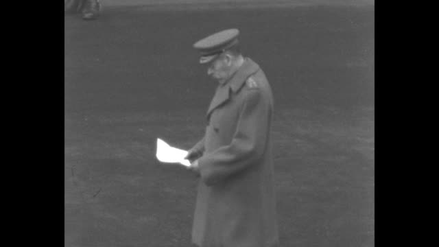 Band of the Royal Corps of Signals play Oh God Our Help In Ages Past at Armistice Day at the Cenotaph / King George V wearing military jacket holds a...