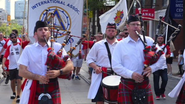 a band of the traditional musicians playing pipe bags they belong to local 30 the toronto labor day parade is a traditional annual event in the... - trade union stock videos & royalty-free footage