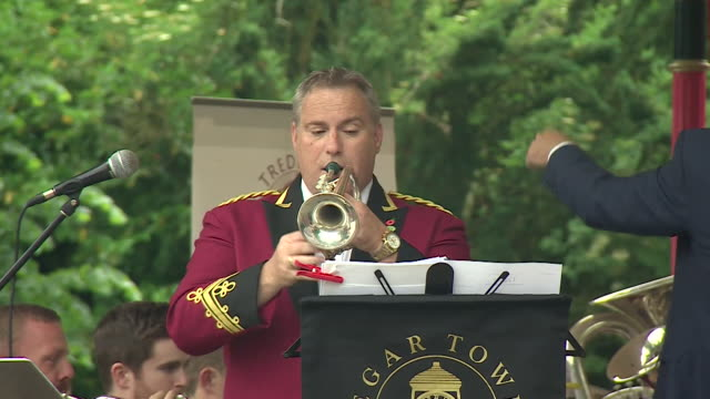 a band performing a song and a miners lamp being presented in tredegar wales in a remembrance event for aneurin bevan founder of the nhs - brass band stock videos & royalty-free footage
