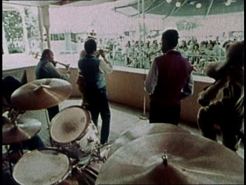 1975 montage band playing and disney characters, including winnie the pooh and tigger, dancing for applauding audience / united states - 1975 stock videos and b-roll footage