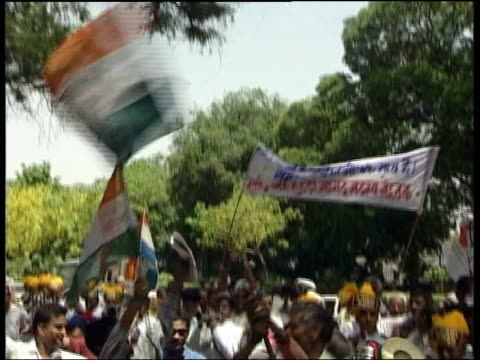 band playing in street celebrations pan to people dancing tms feet of men dancing ms men shaking ribbons gv people dancing in celebration car along... - congress party stock videos and b-roll footage