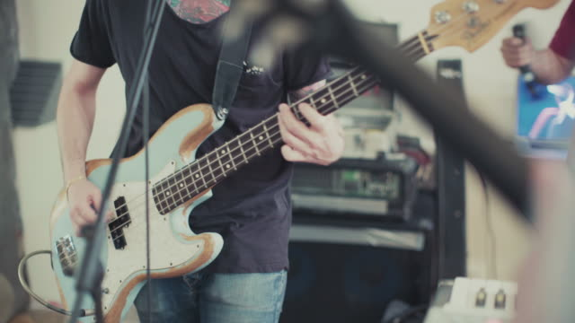 band playing in their rehearsal studio: the bass guitar - pop musician stock videos & royalty-free footage