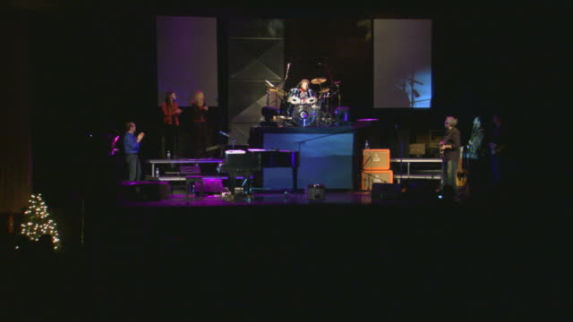 Band playing on stage, zoom out