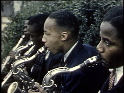 1940 montage band playing outside a school / boligee, alabama, united states - trombone stock videos & royalty-free footage