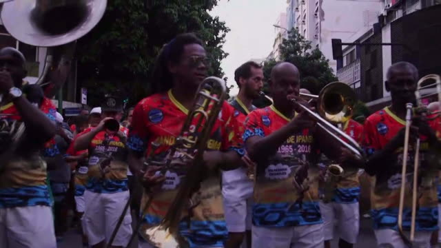 ms band plays in the middle of the street during banda de ipanema festival in rio de janeiro brazil men wear matching clothes and play horns... - matching outfits stock videos & royalty-free footage