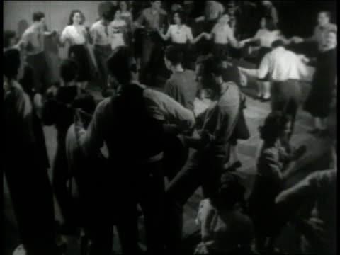 vídeos de stock e filmes b-roll de 1946 montage band provides the soundtrack for square dancers as man calls out steps - dança quadrada